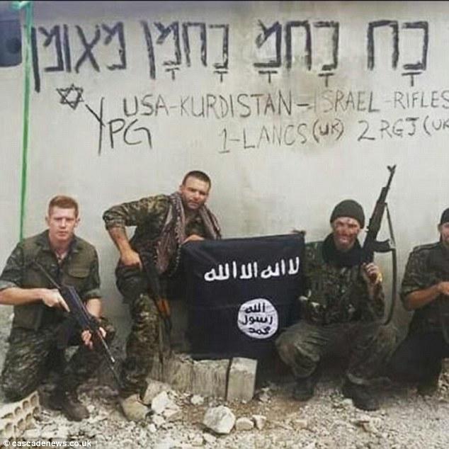 milisi Kurdi YPG mengibarkan bendera ISIS dan ada tulisan di dinding: USA-Kurdistan-Israel.